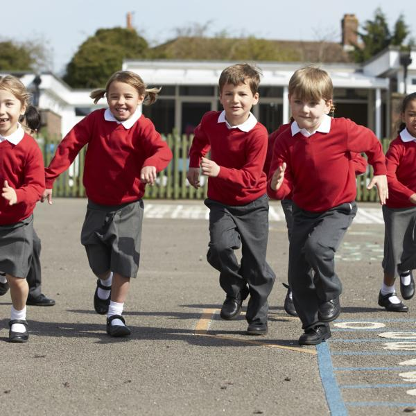 Kids running in school playground